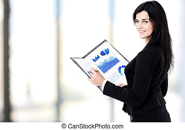 Smiling business woman holding document on clipboard.