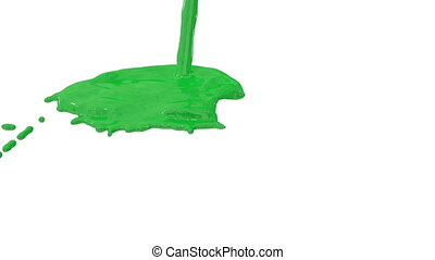 Flow of green paint splattering on white background and...
