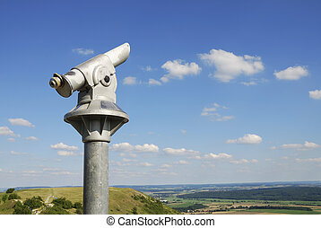 Coin telescope on top of a hill