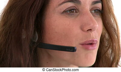 Pretty hispanic businesswoman wearing headset against a...