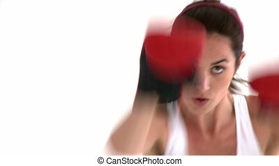 Athletic hispanic woman with boxing gloves against a white...