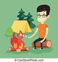 Woman roasting marshmallow over campfire. - Young asian man...