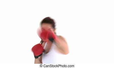Hispanic woman wearing boxing gloves against a white...
