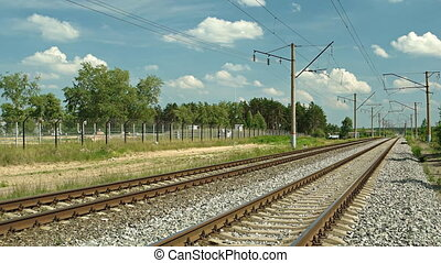 Dual Train Tracks Run through a Rural Community in Russia -...