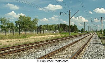 Dual Train Tracks Run through a Rural Community in Russia -...