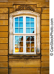 Old white window and yellow building facade, Copenhagen,...