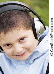 Portrait of smiling kid in headphones