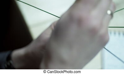 Close up shooting hands of Florist makes basis for flower...