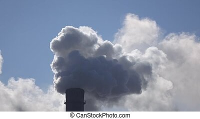 Smog comes out from working pipe in industrial factory, air...