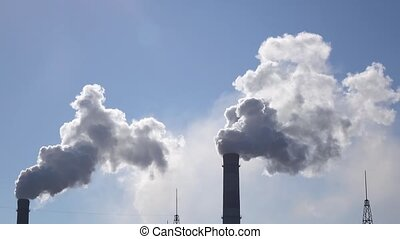 Air pollution from industrial chimneys spew clouds smoke in sky