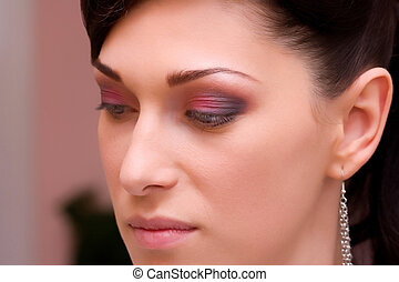 closeup of a beautiful brunette young lady with make up