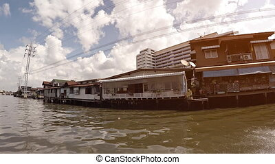 Poor house on the water. River in Bangkok, Thailand -...