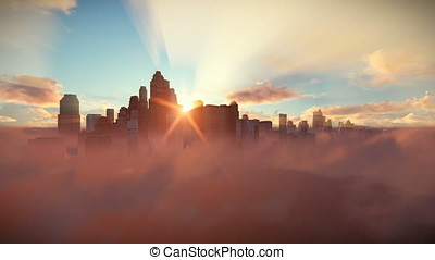 City skyline above clouds at sunset, dolly shot
