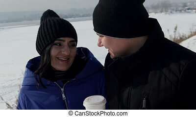 Man and woman drink coffee in picturesque place outdoors....