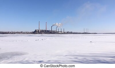 Smokestacks pollute atmosphere, heavy industry. Industrial...