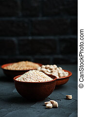 wheat bran in bowls and on a table