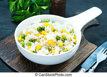 rice with vegetables in bowl and on a table