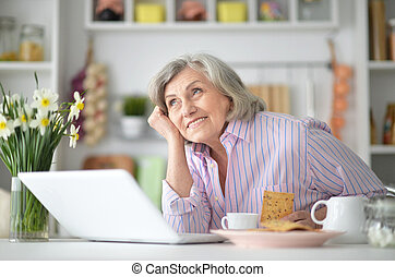 Portrait of an elderly woman having breakfast