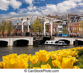 Amsterdam with bridge over canal in Netherlands