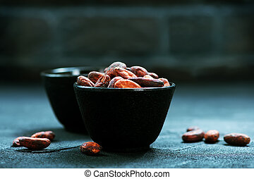 cocoa beans in bowl and on a table