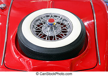 backside of oldtimer car with spare tire