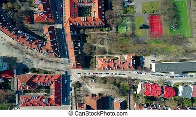 Aerial shot of european city sports grounds in residential...