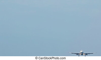 Passenger plane landing in the clear sky. FullHD 1080p 1080p...