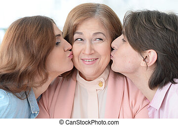 Happy elderly mother with adult  children