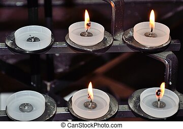 Religous candles inside of cathedral - Religous candles on...