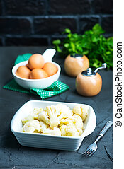 cauliflower - boiled cauliflower in bowl and on a table