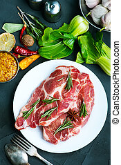 raw meat with spice on plate and on a table