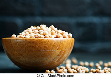 chickpea - raw chickpea in bowl and on a table
