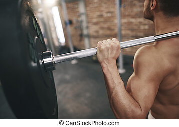 Rear view of man building triceps