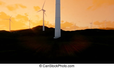 Wind turbine farm on green meadow, rays of light at sunset, tilt