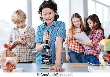 Excited good looking kid working with lab equipment - My...