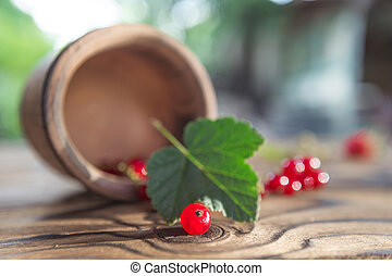 red currant against the background of an old table