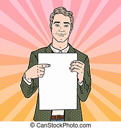 Young Businessman Pointing at Blank Paper Sheet. Business...