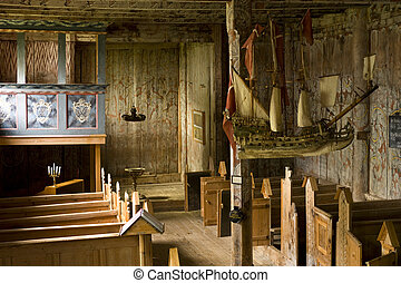 Interior from an old stav church in Kvernes, Norway