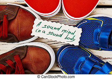 Sport shoes and proverb card. Life-long love for sport.