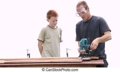 Router Use - Real construction worker teaching a teenage boy...