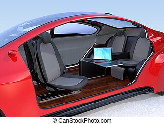 Self driving car interior concept. A laptop computer on the...