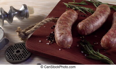 raw sausages , garlic, rosemary and old meat grinder parts -...