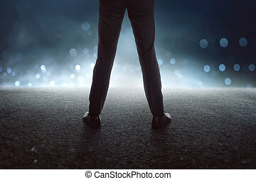 Back view of standing businessman leg with black boots