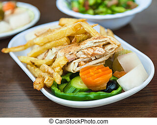 fast food Shawarma with chicken meat on plate - Travel to...