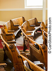 Curved Pews in Church - Wood pews inside a small church in...