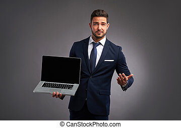 Elegant young man with laptop - An elegant handsome young...