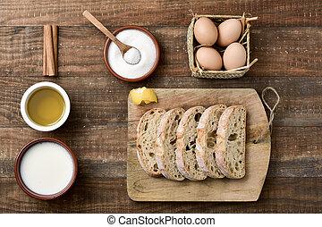 ingredients to prepare spanish torrijas, eaten in Easter -...