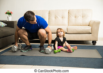 Girl exercising with her father - Sweet little girl training...
