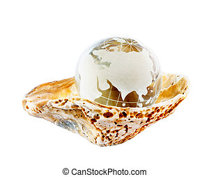 Globe in a seashell isolated on white background.