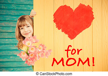 Spring holiday. Mother's day concept - Beautiful child with...